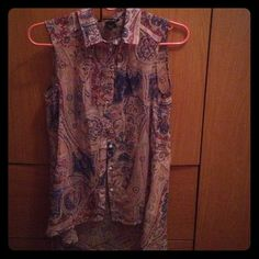 NWOT Beautifully designed sleeveless shirt Great colors and print. Shades of blue and pink. No sleeves. Has collar. High-low style. Great with flats or heels. Great to dress up or down. H&M Tops