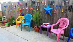 s 12 pool chair ideas we never would have thought of, painted furniture, pool designs, Turn mismatched chairs into a set with color Backyard Chairs, Pool Chairs, Outdoor Chairs, Deck Patio, Backyard Ideas, Outdoor Pool, Fence Ideas, Outdoor Spaces, Backyard Toys