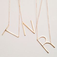 You need to rock this gold large initial necklace around your neck.