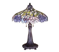 Life and light. Stylized wisteria flower clusters of China pink, grape, and amethyst blue drape over this ivory-toned graceful stained glass and copper foil lamp shade. From Meyda Tiffany. Tiffany Stained Glass, Stained Glass Lamps, Tiffany Glass, Art Nouveau, Antique Lamps, Vintage Lamps, Chandeliers, Copper Table Lamp, Lamp Table
