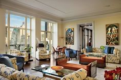 MAC II's Mica Ertegün decorated a couple's 6,000-square-foot penthouse in a midtown Manhattan condominium building by architect Robert A. M. Stern. In the living room, a pair of oils by Thomas Hart Benton flanks the doorway.