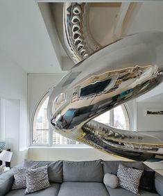 Tentacle-Like Tubular Slide Swirls Through NYC Penthouse - Slide 4