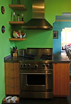Cute work space design for a small kitchen with a touch of green - www.remodelworks.com #kitchen #small