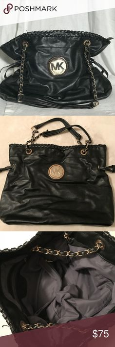 Michael Kors Bag What can I say about this bag?? It's Gorgeous!! The handle is a chain leather with drawstrings on the side. Plenty of room and pockets Michael Kors Bags Hobos