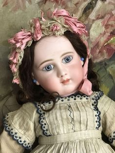 Beautiful and perfect Schmitt bebe with wonderful eyes and original brunette mohair wig with cardboard pate and cord. He is marked head and body see my pictures. Completely dressed with antique