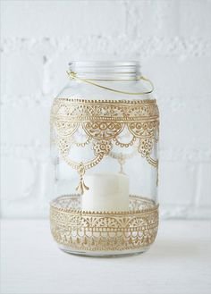 Light up your night with mason jar lanterns. Use them to hang from the trees, line the aisle of your ceremony, or illuminate indoor spaces. These hand painted mason jar lanterns come from Free People but could also be easily DIY'd.