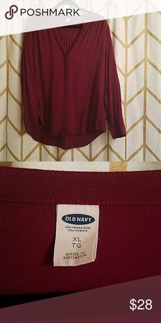 Old navy loose-fitting button down v-neck blouse Rich maroon/Bordeaux color in a great fitting top with cute shoulder details and covered buttons. Good for work or play, with pencil skirts or jeans. Old Navy Tops Blouses