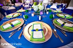 green/blue travel theme wedding, beautiful and creative new spin on reception menus, tied together with a satin royal blue ribbon and small flower.