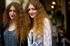 Gorgeous long haired twin girls