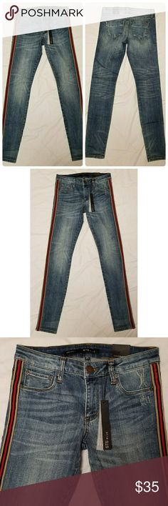 """STS Blue Piper Skinny Jeans Brand new with tags, juniors STS Blue Piper Skinny jeans, size 25. They have a red, navy and khaki trim running down each leg.   99% cotton/1% spandex   Waist: 28"""" Inseam: 30.5"""" Outseam: 38"""" Front rise: 8"""" Back rise: 12.5"""" Hips: 30"""" Leg opening: 10""""  All items come from a smoke and pet free home. STS Blue Jeans Skinny"""