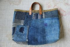 This is Japanese boro bag, made of few vintage japanese indigo boro cottom. They are sew pieces together by hand sashiko stitching.  Lining and