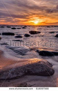April evening at the Baltic Sea in Estonia. Beautiful sunset over the Gulf of Finland coast. Shutterstock contributor.