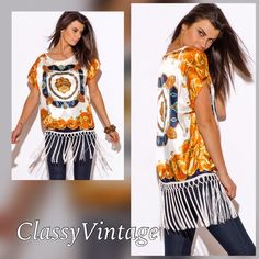 Stunning satin tunic with fringe. This is size Small . Orange and blue on off white. Long fringe tunic. Made in USA and run true to size. Boutique Tops Tunics
