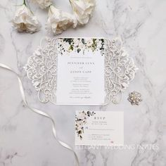 glittery silver and blue winter snowflake wedding invitations with pearl white buckles EWWS216 Inexpensive Wedding Invitations, Laser Cut Invitation, Laser Cut Wedding Invitations, Affordable Wedding Invitations, Pocket Wedding Invitations, Floral Invitation, Bridal Shower Invitations, Wedding Stationary, Pocketfold Invitations