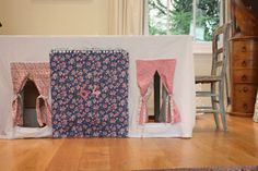 Sisters Guild: Monday Makery - tablecloth play house - thorough tutorial that even suggests attaching curtains and door with Velcro for easier washing