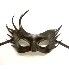 Hey, I found this really awesome Etsy listing at http://www.etsy.com/listing/154440034/asymmetrical-abstract-black-leather-mask (pretty)