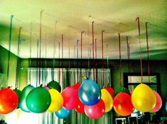 Balloons Hanging from the Ceiling. This is genius! We used fishing line to hang balloons and it looked awesome. The balloons appear to just be floating in the air. Our 2year old daughter LOVED them. Great inexpensive party decoration.
