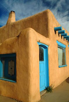 indian adobe house pictures blue door | Adobe Homes