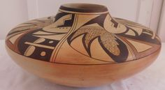"""53: Large Hopi Polychrome Olla, circa 1950s. Made of clay and paint, the items measure 11"""" x 11"""" x 5.75"""". Hopi, signed Little Fawn. Condition: Major crack and repair, see images. Shipping: $40.00 w/insurance and signature."""