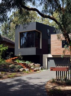 Iron, concrete block and wood cladding