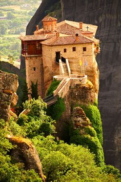 Greek Orthodox Rossanou Monastery, Meteora Mountains, Greece.  Go to www.YourTravelVideos.com or just click on photo for home videos and much more on sites like this.