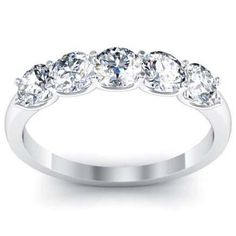 There is nothing like a gorgeous moissanite rose engagement ring to set her heart aflutter. Designed in striking detail, the band features a rose motif with a variety of side accent diamonds. A large focal moissanite sits atop in all its splendid glory. Eternity Ring Diamond, Diamond Bands, Diamond Jewelry, Eternity Rings, Halo Diamond, Gold Jewelry, Fine Jewelry, Diamond Anniversary Bands, Anniversary Rings