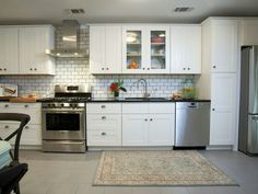 White subway tiles, black counters with stainless steel appliances.