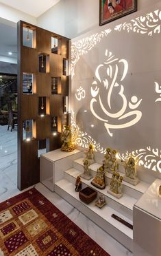 Pooja This Puja space designed inside the modern living room gives it a spiritual ambience allowing a continuous cycle of energy flow throughout the house. Sky Box House designed by Garg Architects Temple Room, Home Temple, Living Room Modern, Living Room Designs, Indian Living Rooms, Box House Design, Temple Design For Home, Room Partition Designs, Living Room Partition Design