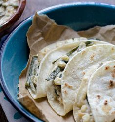 """Vegan Rajas con Crema Tacos is one of those true Mexican comfort dishes. Poblano peppers are roasted over an open flame, peeled, cut into strips, then sauted with onion, garlic, and corn. A thick, slightly sour """"crema"""" is poured over the whole thing. It is spicy, creamy, and incredibly satisfying"""