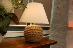 24 Living Room DIYs: Get on board with the nautical trend by adding rope to a simple lamp base.