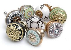 Black & Gold similar Anthropologie Lace-Strewn Knob $6.44 each. Great with ikea liatorp office desk.