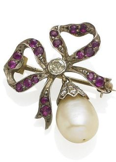 An antique pearl, ruby and diamond brooch/pendant. Designed as a drop-shaped pearl, measuring approximately 7.9 x 8.6 -9.5mm, with rose-cut diamond cap, suspended from a plaque modelled as a bow, set throughout with circular-cut rubies and an old-cut diamond centre, mounted in silver and gold.