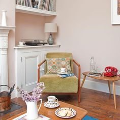 That floor, that chair off set with that cushion, the Ercol style table... can't decide which bit to love the most!