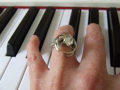 Zilveren/gouden ring met Rutielkwarts in een gouden zetting - diana buitink jewelry -