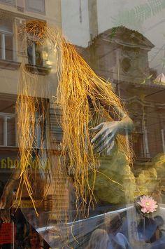 Prague mermaid. Reflections of a window display in Old Prague. 2007. Photo Chalres Stirton