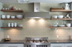 Kitchen:  white, stainless, soft griege subway tile & a smidge of natural wood.