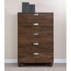 The Mirella 5-drawer chest features an understated design with a rich pecan brown finish over a reliable rubberwood construction. With five drawers of generous storage, this bedroom storage unit is completed by nickel-tone drawer pulls.