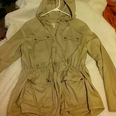 Michael kors coat Never worn. Thin material. Great for a layered look! No pets. Non smoker. Perfect condition. Gold buttons. Pull string waste. This coat has a thin material. Michael Kors Jackets & Coats