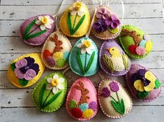 Felt easter decoration - felt eggs / set of 12 - bright spring colors Listing is for 12 ornaments - 8 eggs with various flower designs - 3 eggs with bunny - 1 egg with chicken If you would like different set please send me a message and we will work out options. Handmade from wool blend