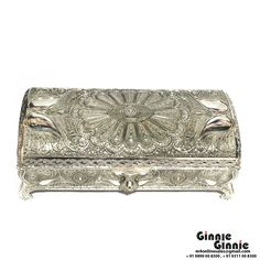 This Ginnie & Ginnie Exclusive Jewelry  Box Filigree work is a product from our Kitchen & Dinning Improvement Collection. It is made of Alloy and it got Silver Lacquer Coating finish on it. Its approx LxWxH is 9x4.5x3 inches. It is of approx 1040 grams. Unique Code of this product is M400405.09
