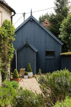 The cabin, newly clad in corrugated metal, sits outside Archie and Caddie's house in the Cotswolds. Black Shed, Black House, Black Barn, Garden Workshops, Tin House, Timber Cladding, Garden Studio, Corrugated Metal, Backyard