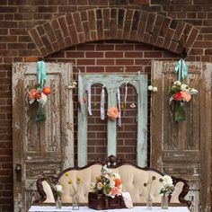 A soft vintage romance wedding tablescape from Victorian Seasons in Apex, NC, with pops of teal, coral and ivory. Photo by Walters & Walters