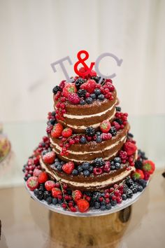mixed berry wedding cake - Read more on One Fab Day: http://onefabday.com/knockniny-country-house-wedding-by-eden-photography/