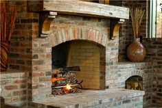 brick fireplace with rustic wood mantel