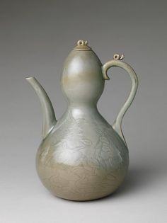 """Gourd-shaped ewer with decoration of waterfowl and reeds, early 12th century. Goryeo dynasty (918–1392). Korea. The Metropolitan Museum of Art, New York. Fletcher Fund, 1927(27.119.2)  