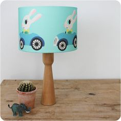 George Rabbit lampshade (blue) by Rebecca Sodergren.   A beautiful, scandi inspired lampshade.  Diameter 30cm, it can be made with either a lamp or pendant fitting.   Ideal for a child's nursery, bedroom or even a lovely feature for a stylish room.  #Kids interiors  #children'sbedroom #nurseryideas  #lampshades #scandidesigns #matchinglampshadeandcushion