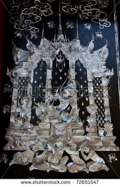 Traditional Thai style church door art, decorated with pieces oyster shell