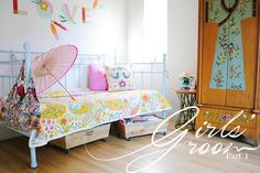 Girls' room decor. Ideas and sources for this cute girly room. Quilt, crates on wheels, armoire and neon tray from @homegoods