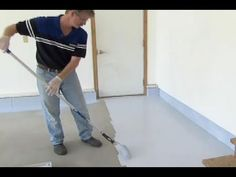 This Old House host Kevin O'Connor assists epoxy-coating expert Doug Fasching in creating a good-looking, hardwearing, stain-resistant garage floor. (See bel...
