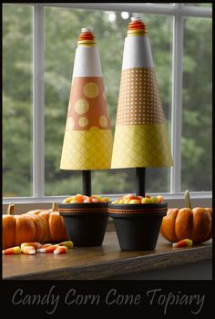 Candy corn Halloween topiaries .... could be created easily using Mod Podge and paper mache cones